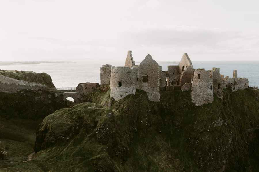 old medieval ruins of dunluce castle on ocean coast in northern ireland famous place in uk